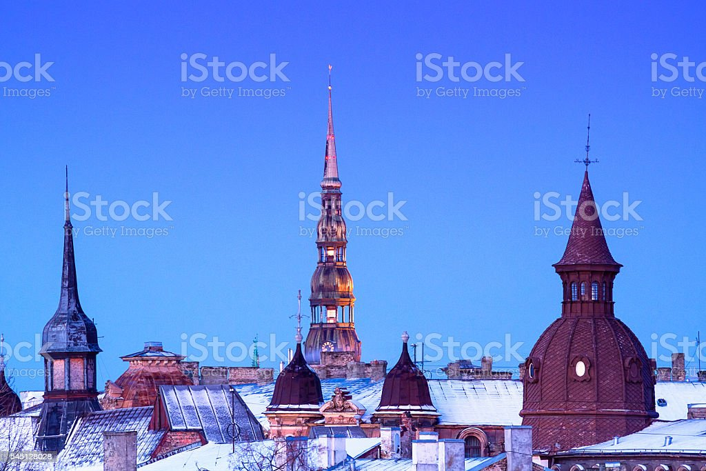 Towers of old Riga in night stock photo