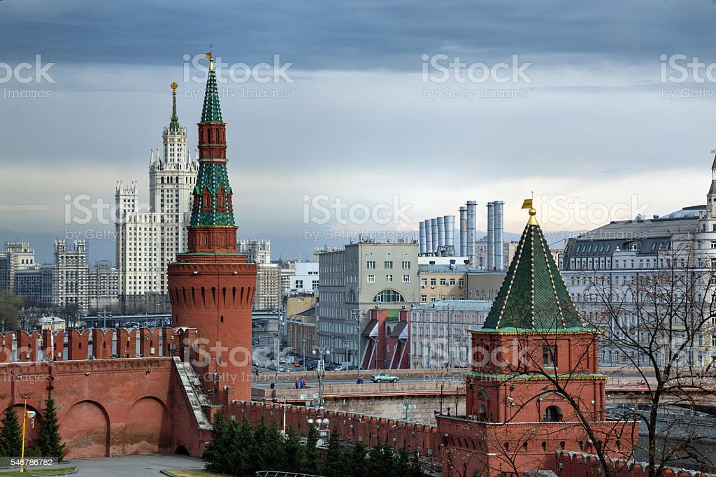 Towers of the Moscow Kremlin and Stalin architecture at the background stock photo
