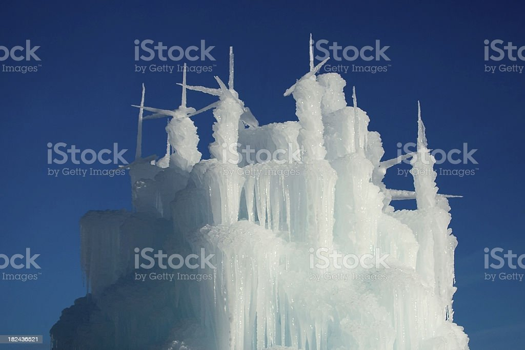 Towers, Spires from a Winter Ice Castle against Blue Sky royalty-free stock photo