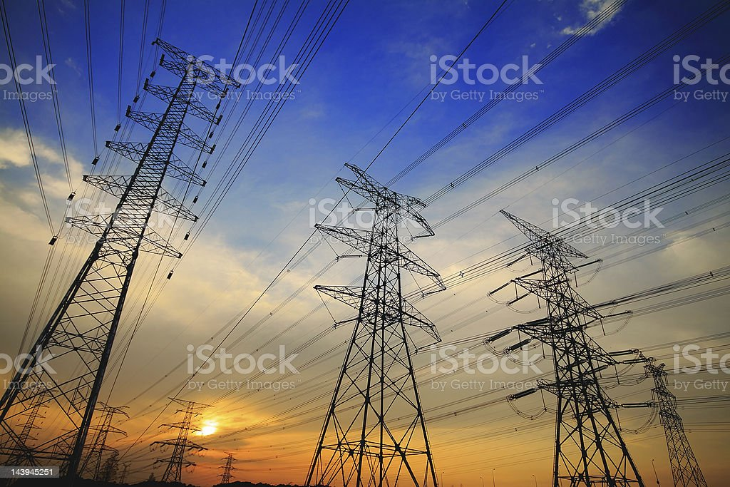 Towers with transmission lines running stock photo