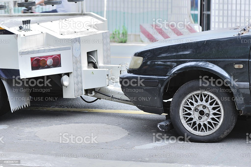 Towing a dumped car stock photo