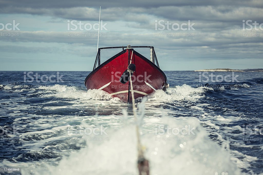 Towing a Red Boat stock photo