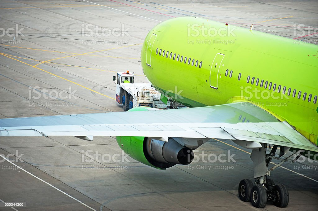 Towing airplane at an airport stock photo