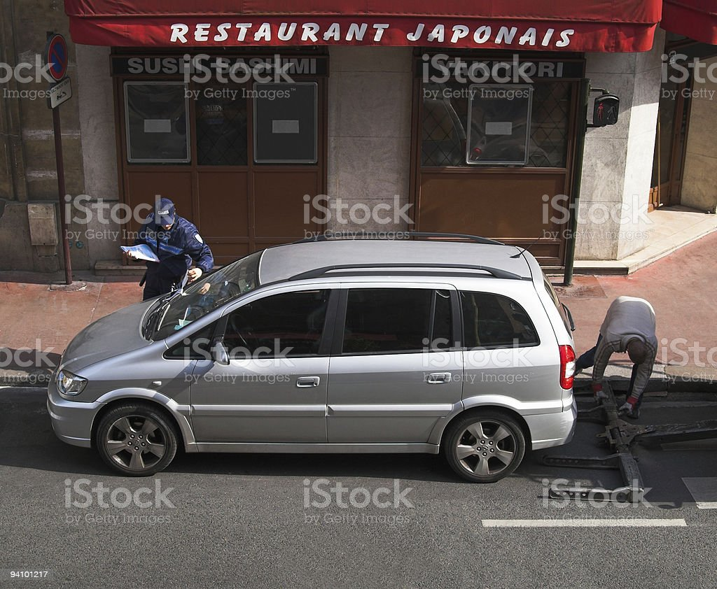 Towing away a wrongly parked car royalty-free stock photo
