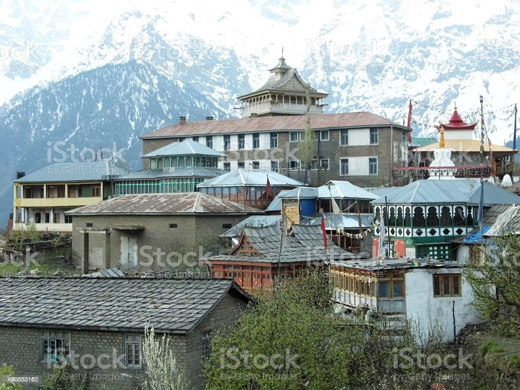 Town amidst Snow capped hills stock photo