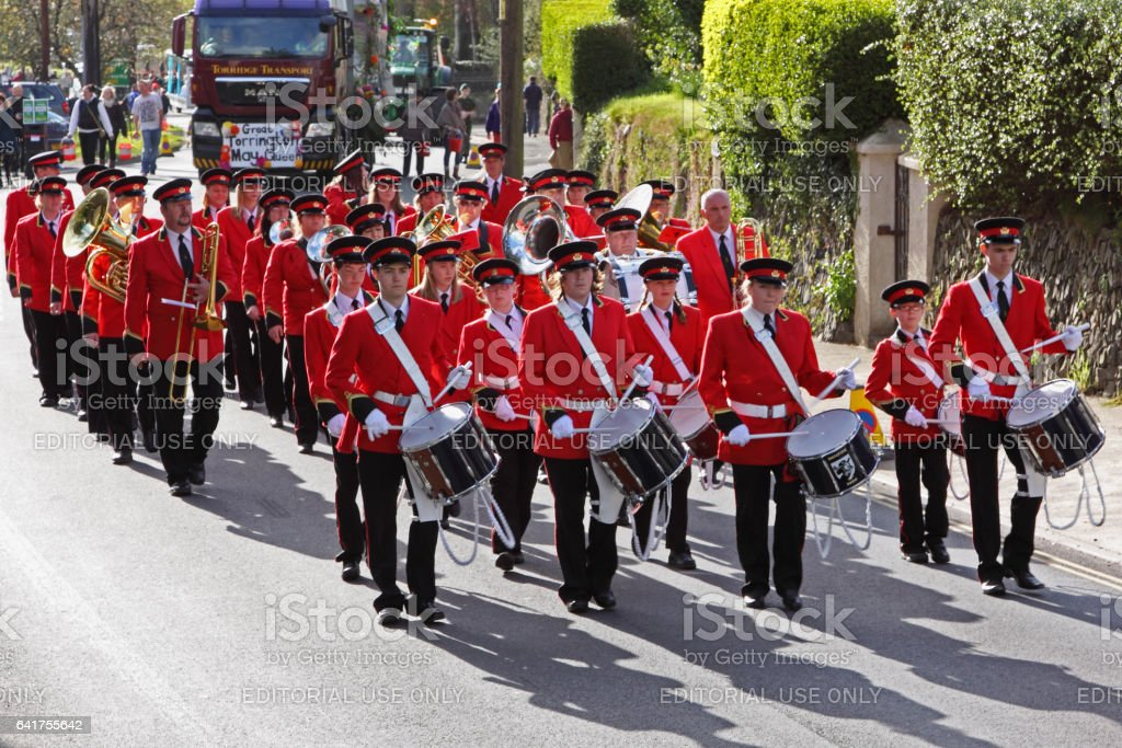 Town band on the march in an annual parade to mark the onset of summer stock photo