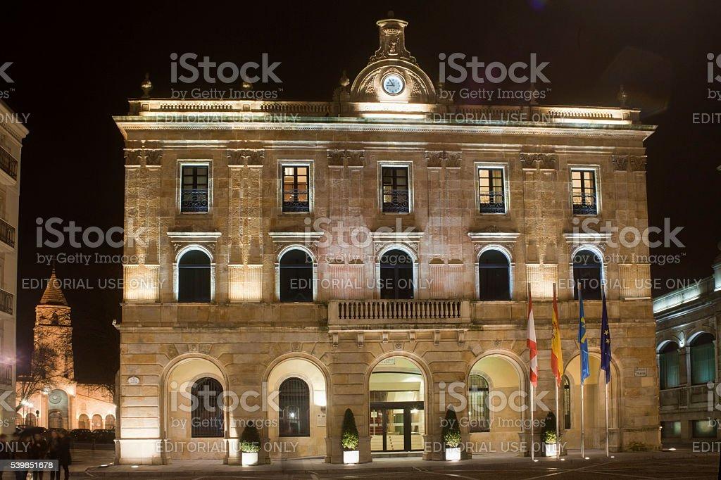 Town hall in Gijón, Asturias, Spain by night. stock photo