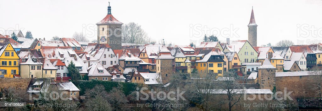 Town of Rothenburg_ob_der_Tauber in winter with snow covered rooftops. stock photo