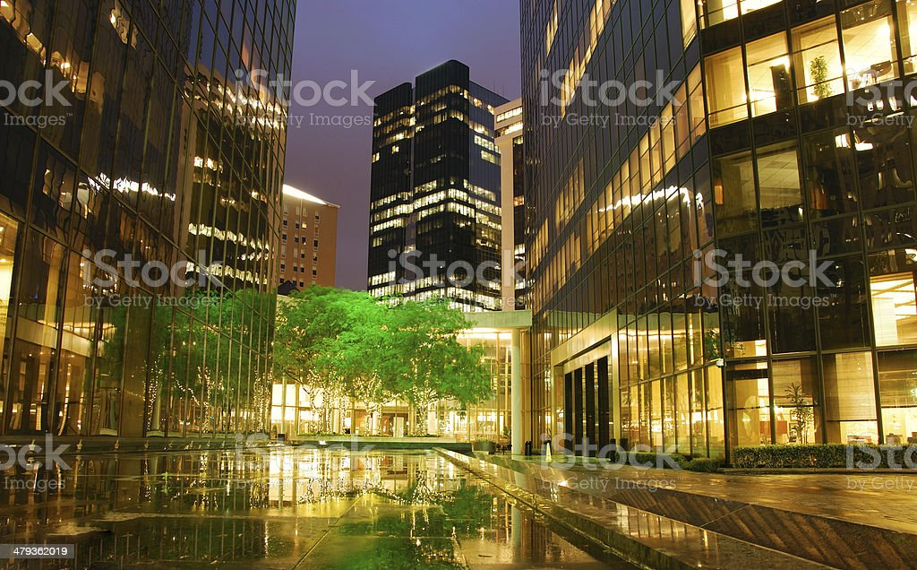 Town square with reflecting lights after rain stock photo
