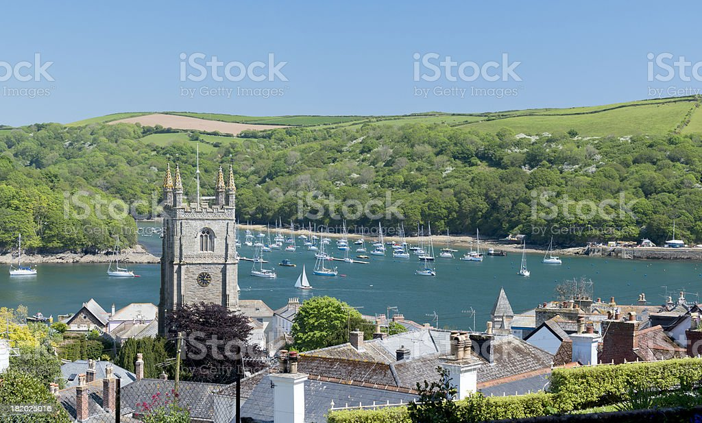 A UK town with a river full of boats. stock photo