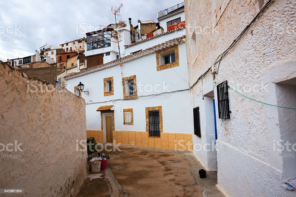 Town  with dwellings houses-caves built  into rock. Alcala del J stock photo