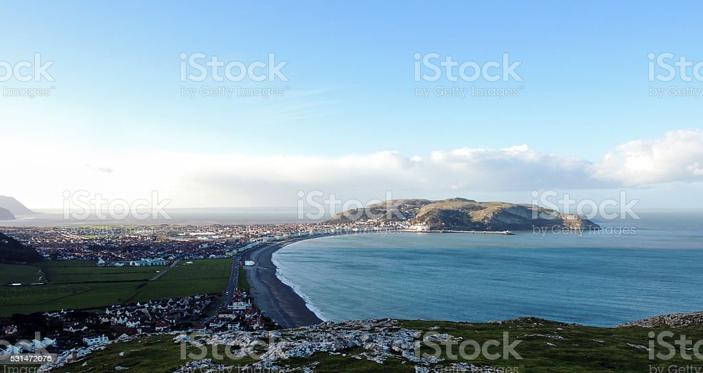 Town/city panorama from hill top and sea bay stock photo
