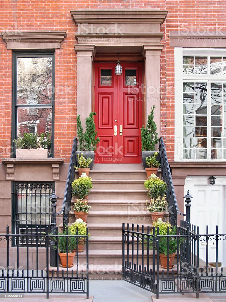 Townhouse entrance with ornate railings and gate stock photo