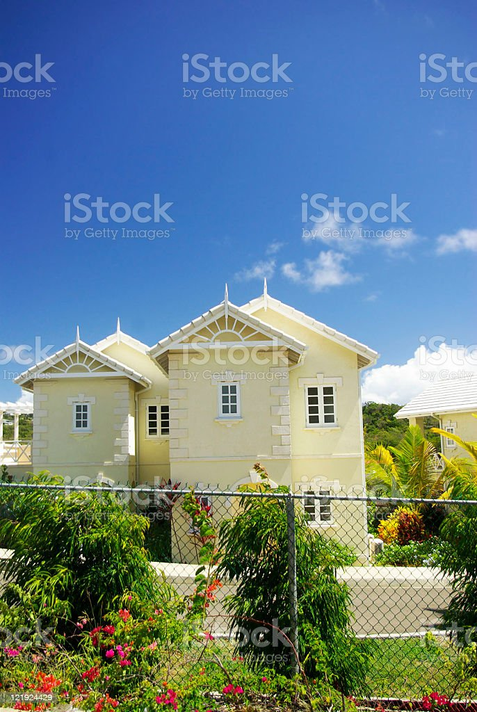 townhouse or villa behind fence stock photo