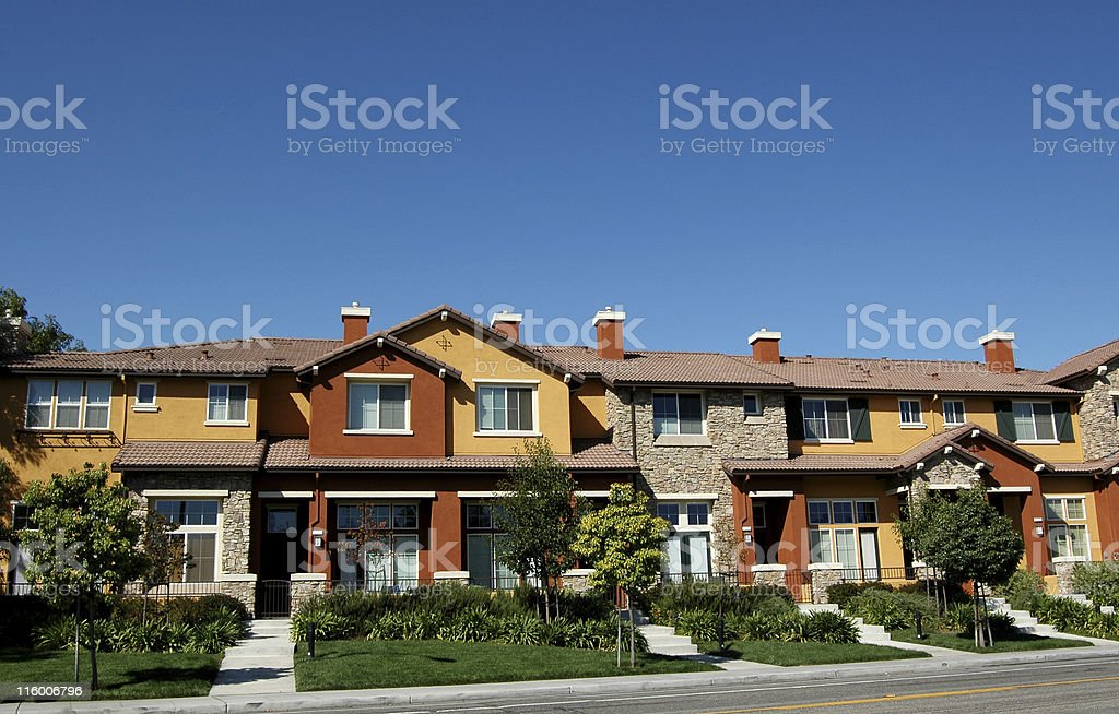 townhouses against clear blue sky royalty-free stock photo