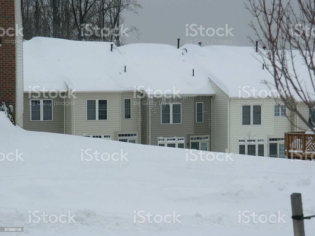 Townhouses in snow stock photo