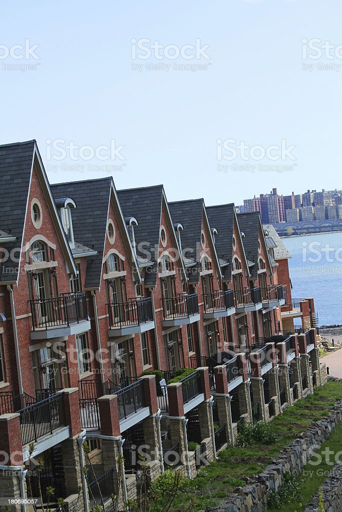 Townhouses on water with cityscape royalty-free stock photo