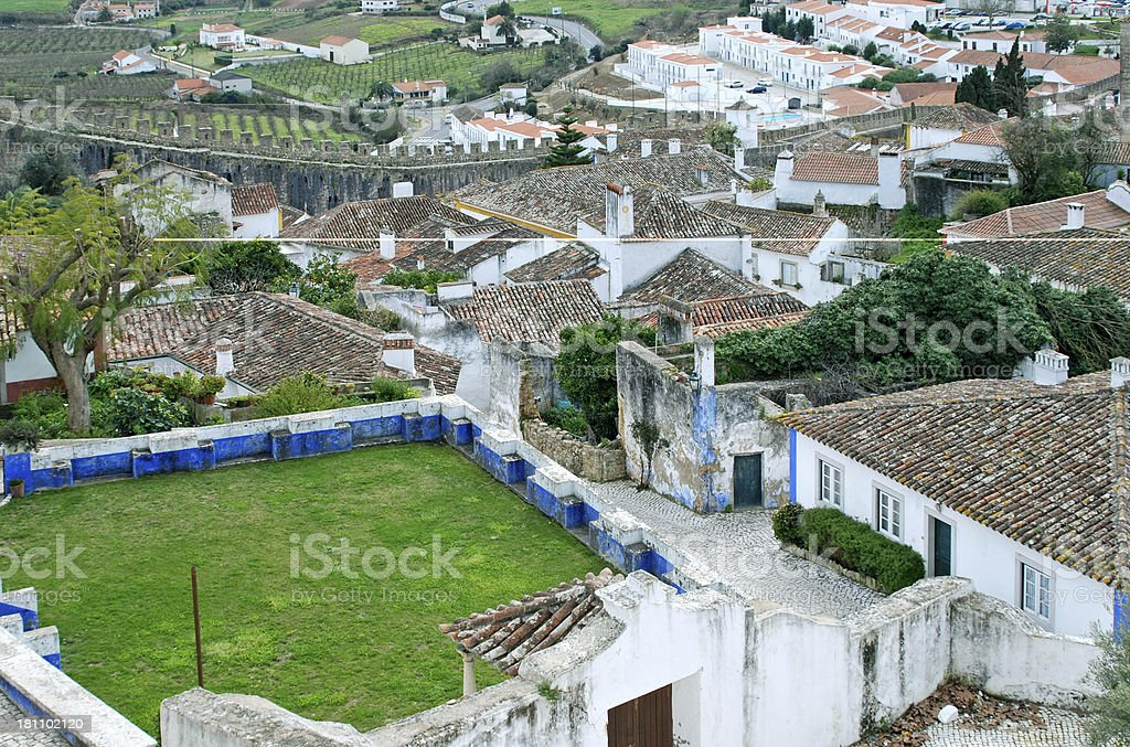 Townscape of Obidos with castle wall and new apartments royalty-free stock photo