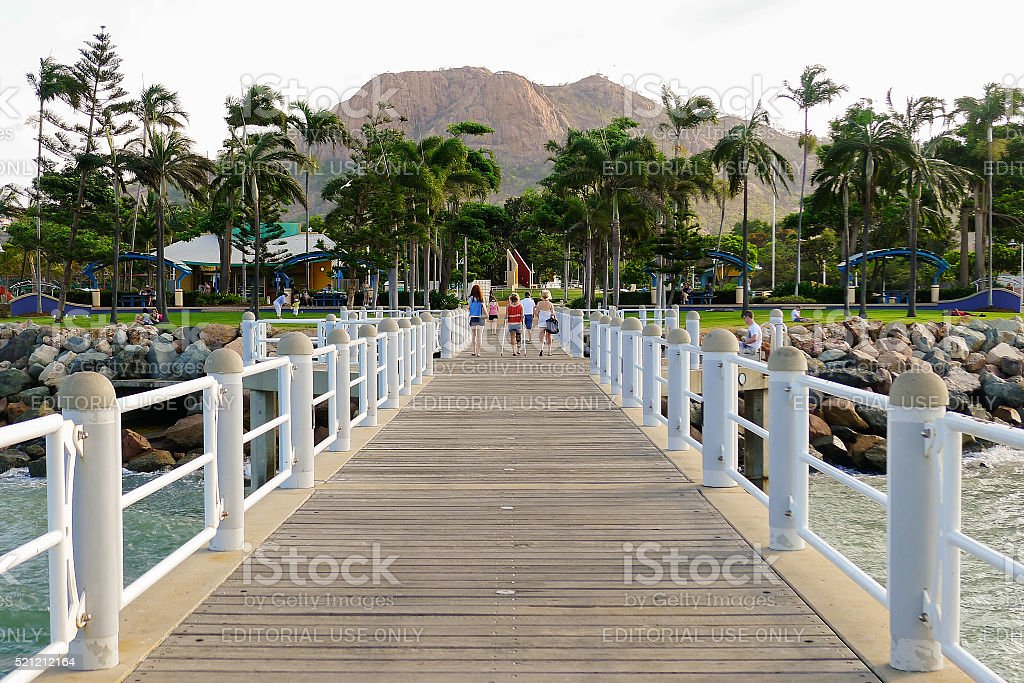 Townsville jetty and Castle Hill stock photo
