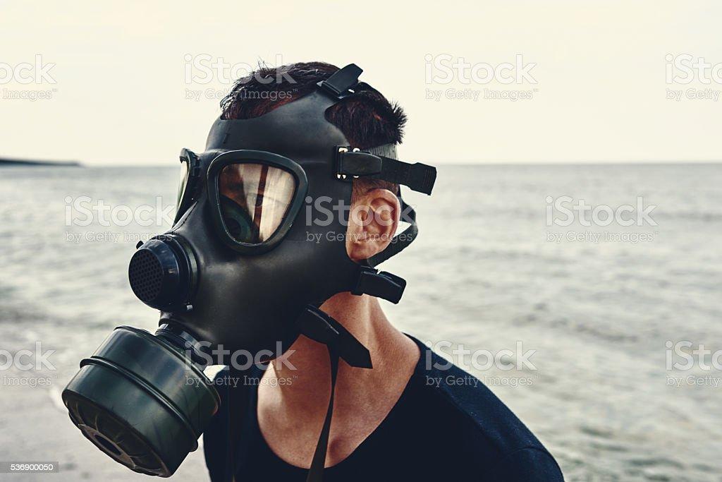 toxic area, man wearing gas mask stock photo