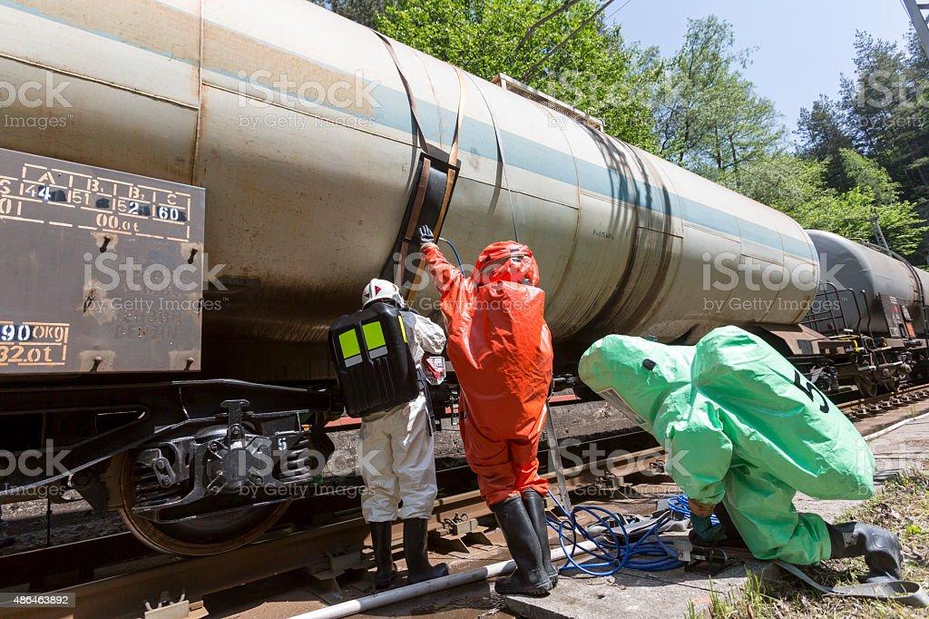 Toxic chemicals acids emergency team train crash stock photo