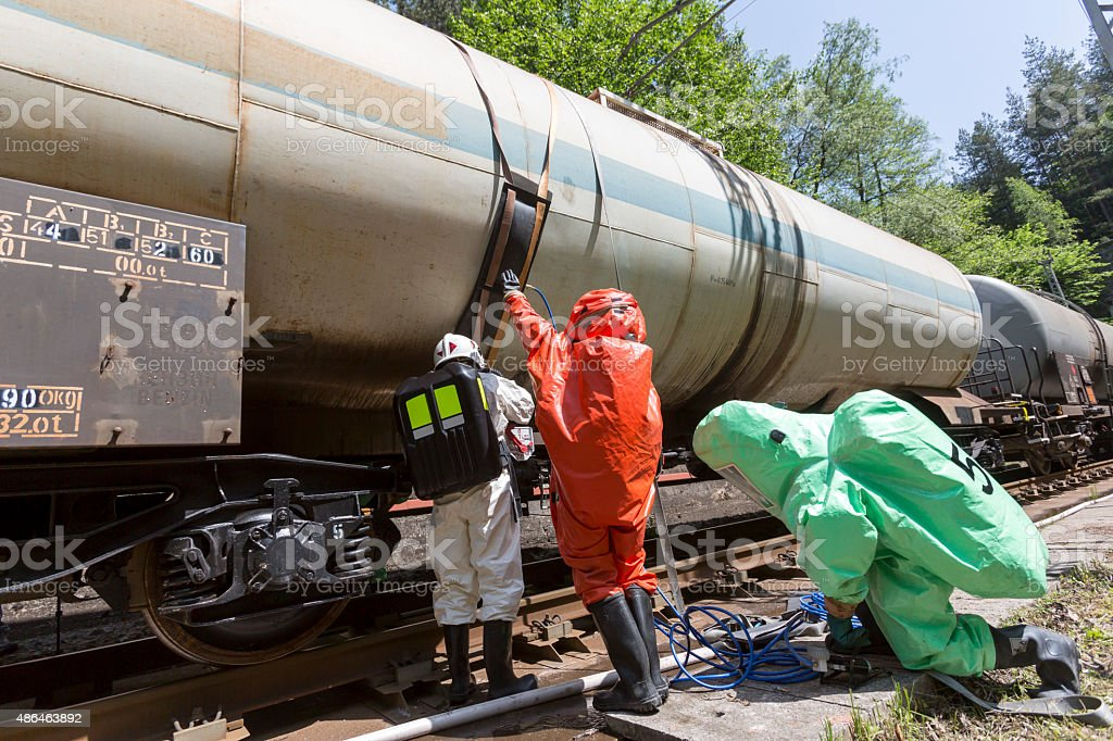 Toxic chemicals acids emergency team train crash stock photo
