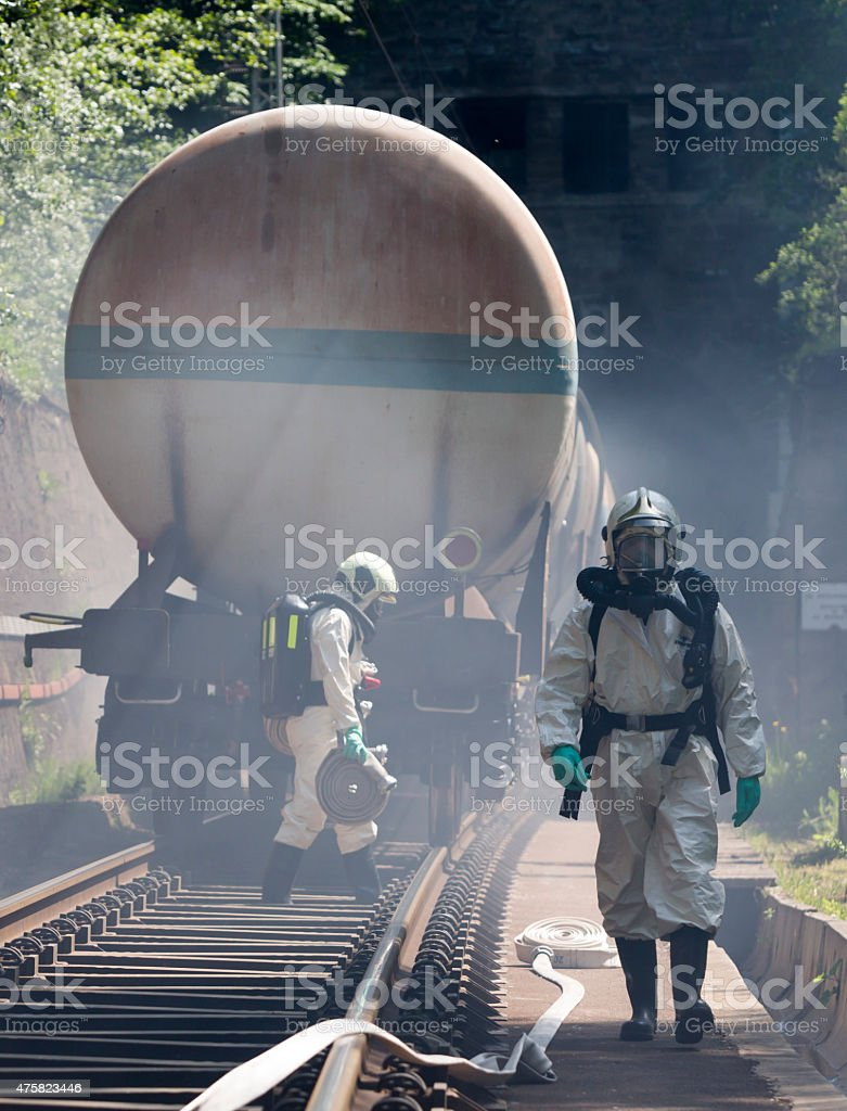 Toxic chemicals acids emergency train firefighters stock photo