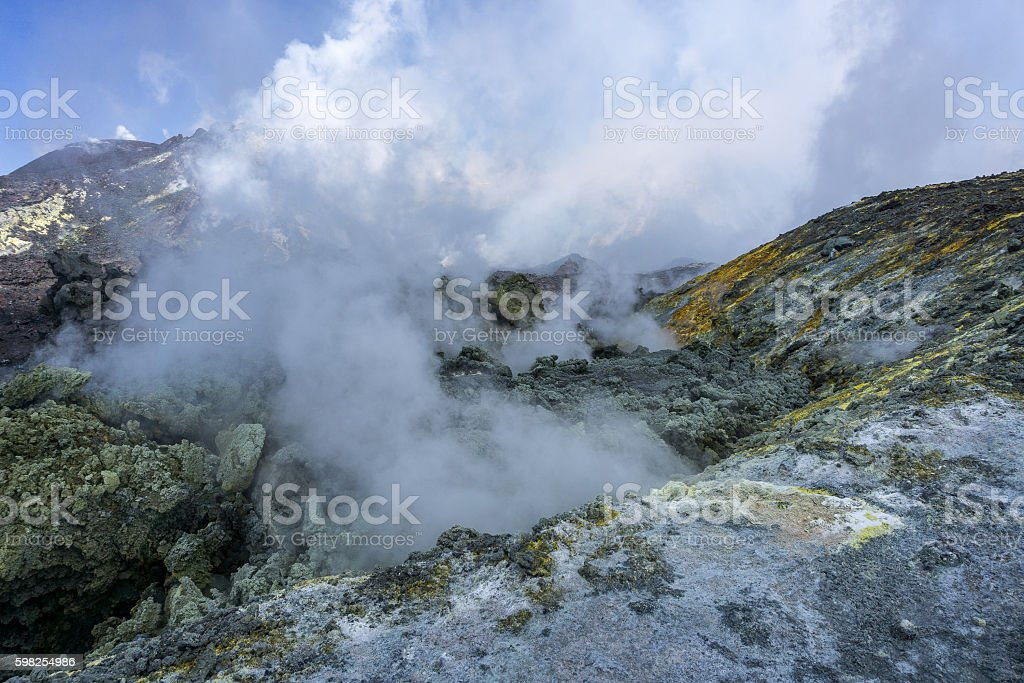 Toxic fumes arise from the crater of volcano Etna stock photo