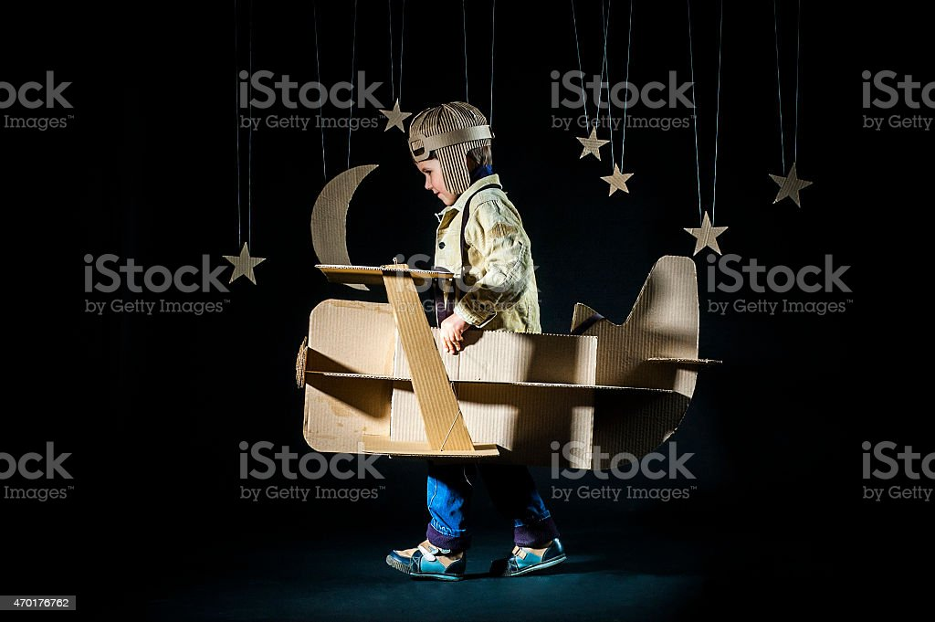 Toy airplane at night stock photo