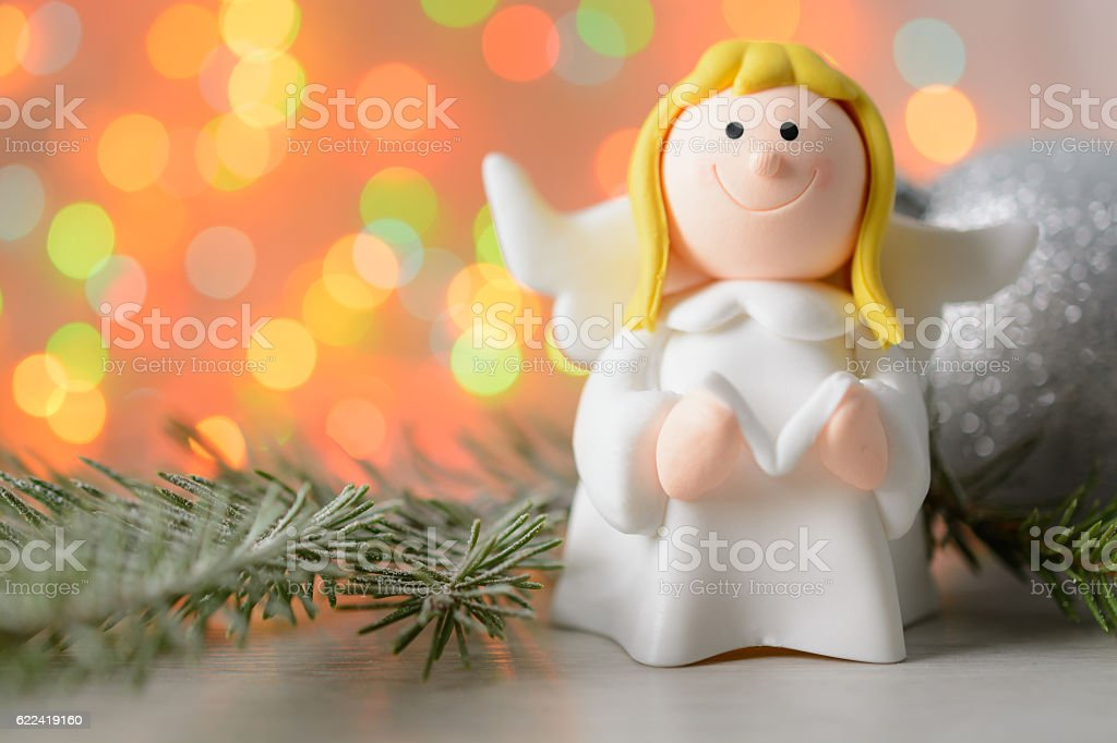 Toy angel with book in hand stock photo