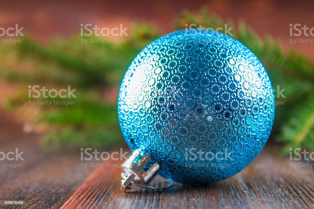 toy balls on the background of Christmas tree branches on a wood stock photo