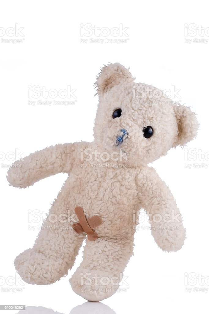 Toy bear bandages on his private parts front view stock photo