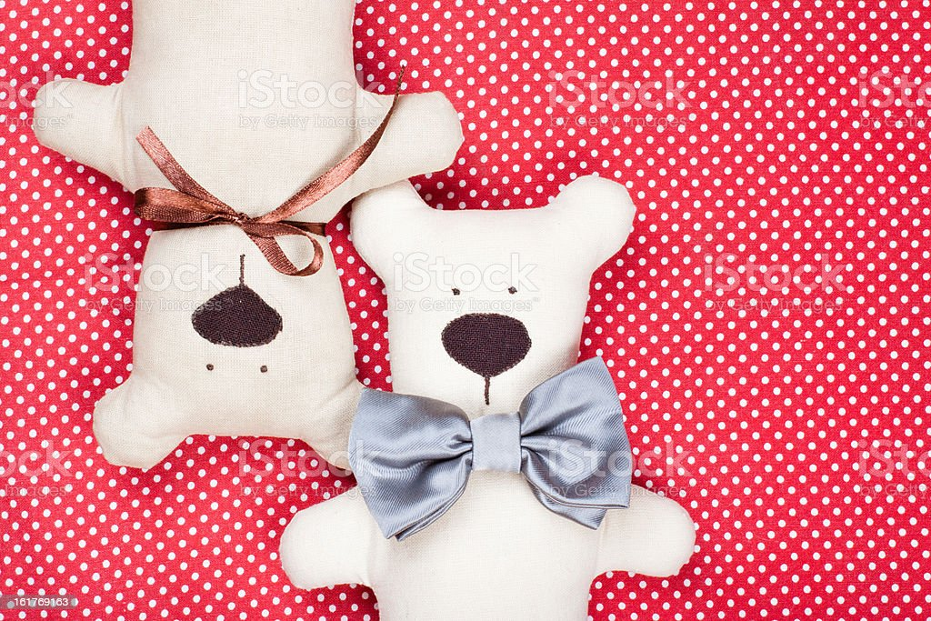 Toy bears couple on red cotton background royalty-free stock photo