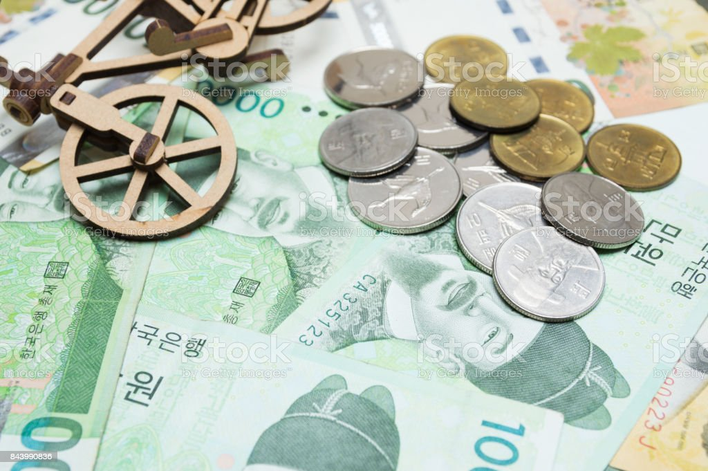 Toy bicycle and coin on South Korean won currency stock photo