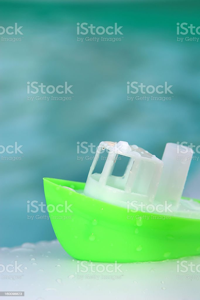 Toy Boat at the Pool royalty-free stock photo