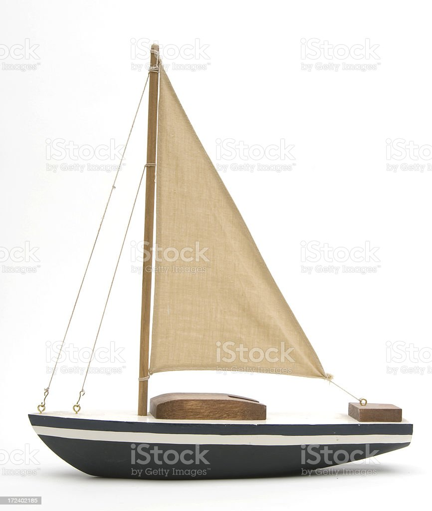 Toy boat with a large brown sail stock photo