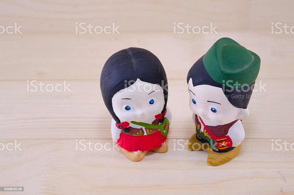 Toy boy and girl in Serbian national wear royalty-free stock photo