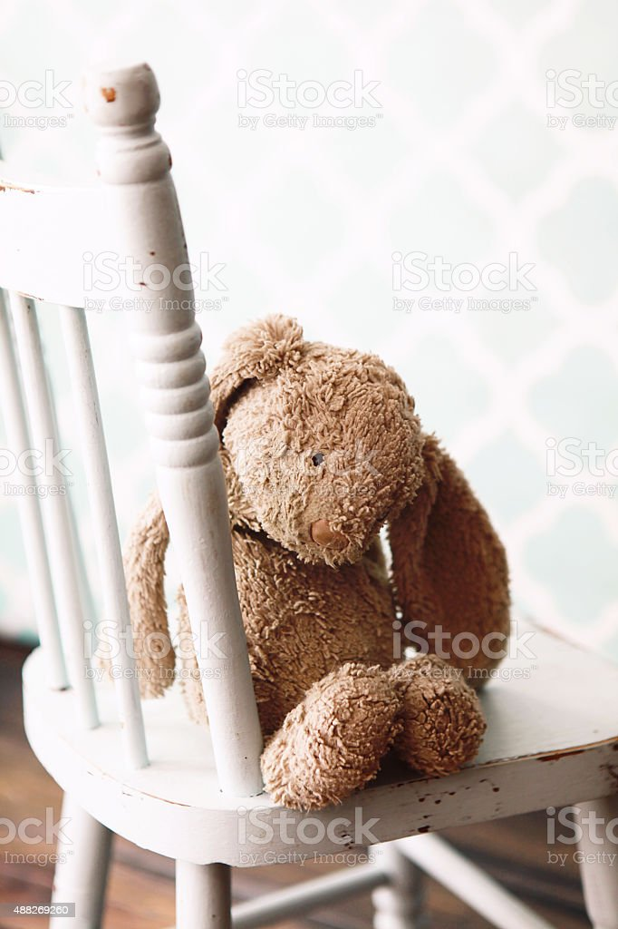 Toy Bunny on Child's Chair stock photo