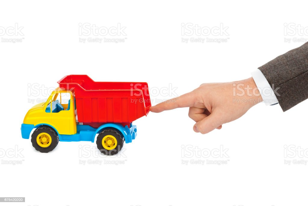 Toy car truck and hand stock photo