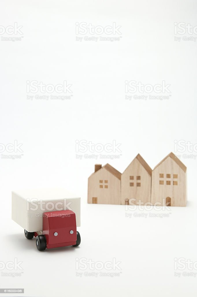 Toy car truck and houses on white background. stock photo