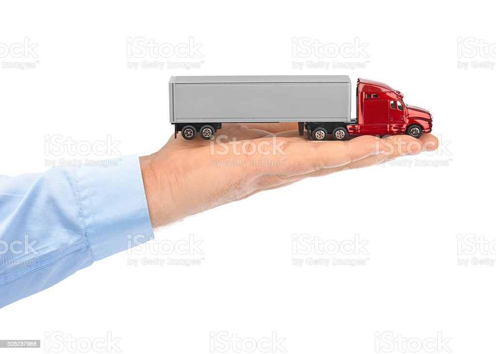 Toy car truck in hand stock photo
