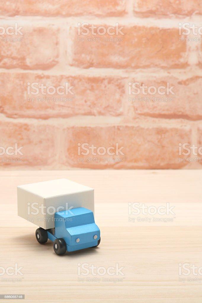 Toy car trucks on wood. Logistics, stock photo
