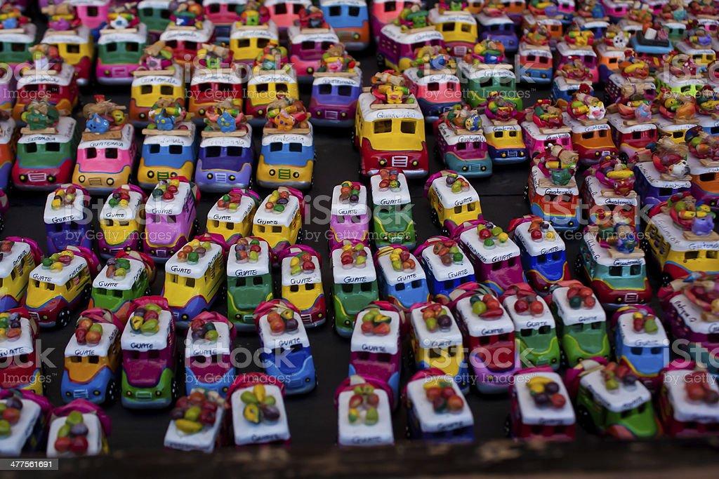 Toy chicken buses at Chichicastenango market Guatemala stock photo