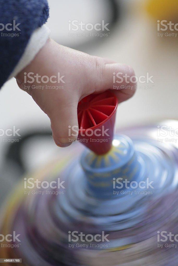 Toy child hand pegtop stock photo