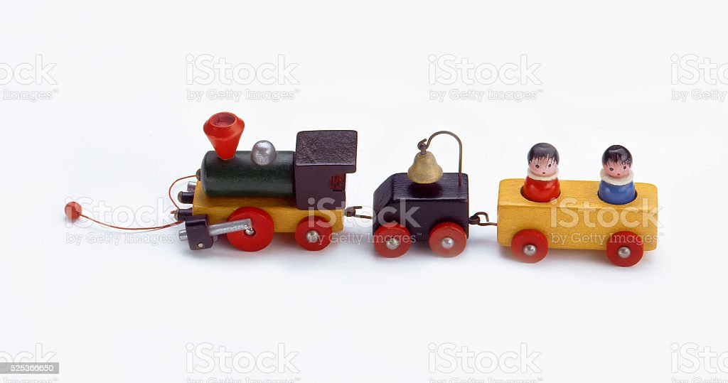 Toy colorful wooden train on white background stock photo