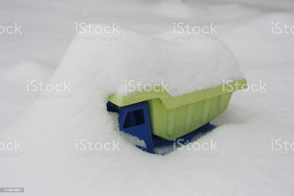 Toy Dump Truck Covered With Snow stock photo