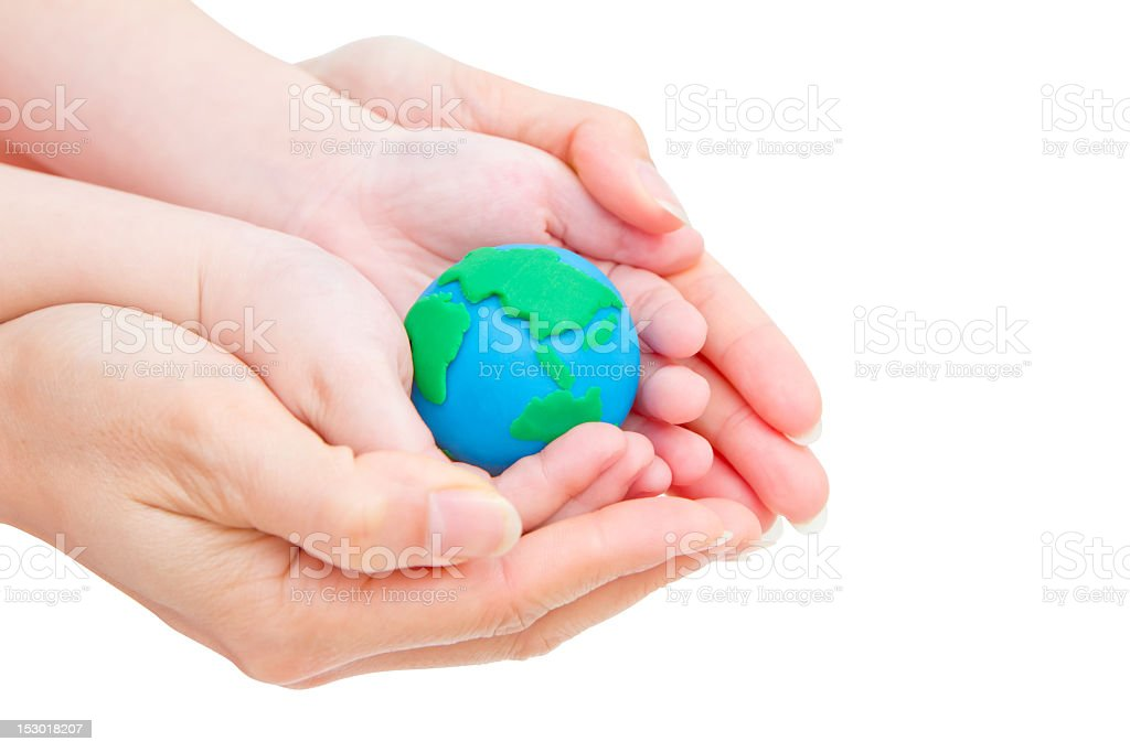 Toy Earth on baby and mum's hands royalty-free stock photo
