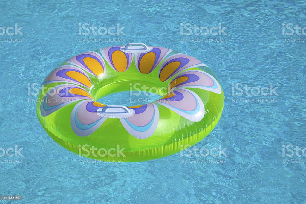 toy floating in pool royalty-free stock photo