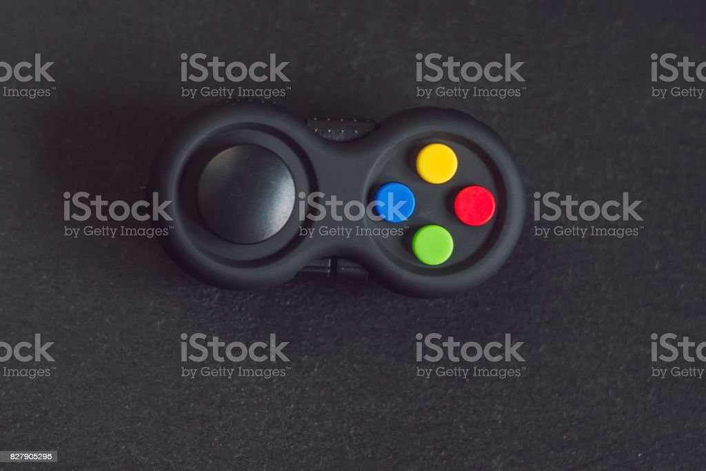 Toy game joystick on a black wooden background stock photo