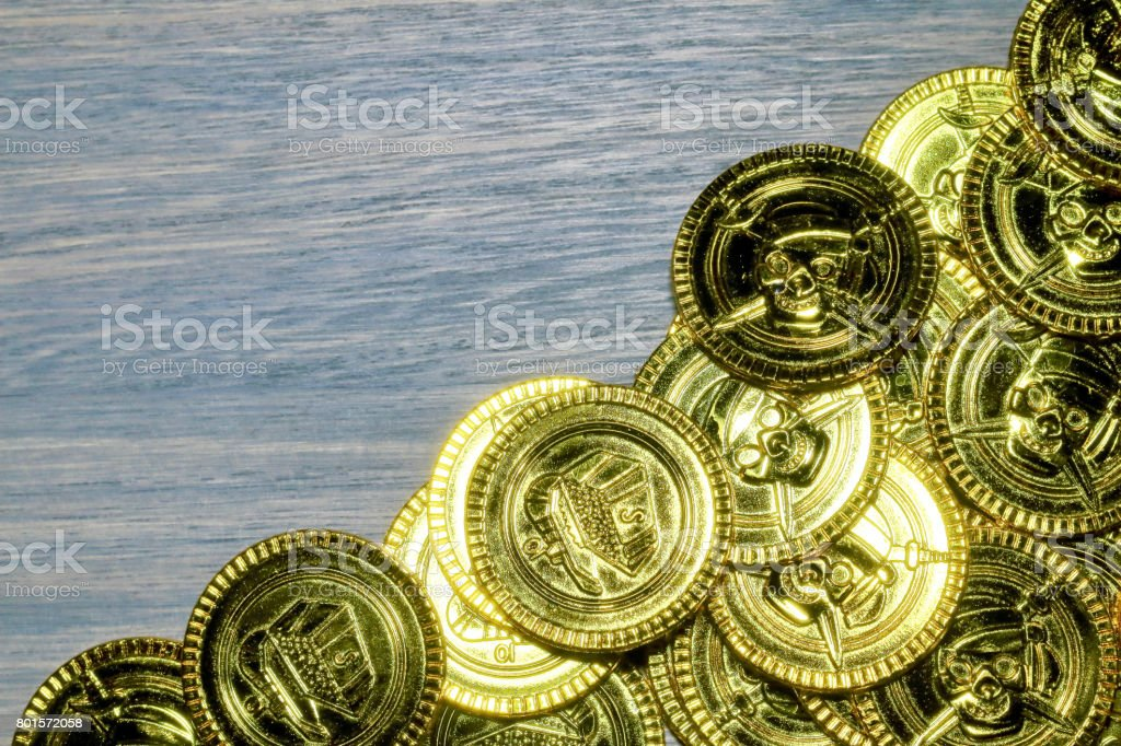 Toy gold coins and wood bo stock photo